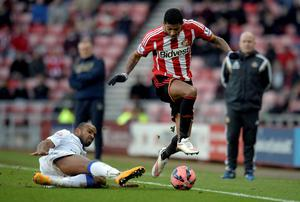 Sunderlands Patrick Van Aaholt (right) and Leed's United's Rodolph Austin during the FA Cup, Third Round match at the Stadium of Light, Sunderland