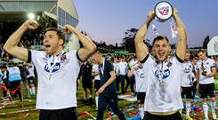 Dundalk player's Brian Gartland, left, and Patrick Hobin celebrate with the cup after the game. EA Sports Cup Final