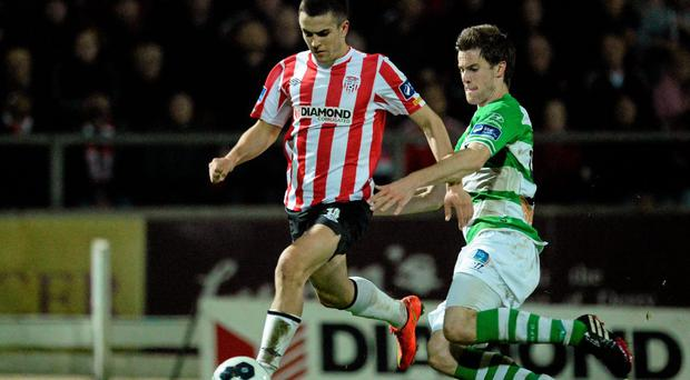 Michael Duffy of Derry City in action against Alan O'Connor of Shamrock Rovers last season.