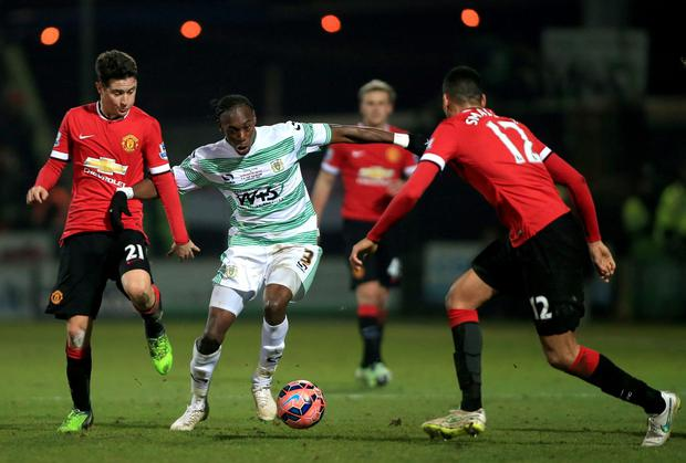 Manchester United's Ander Herrera (left) and Chris Smalling battle for the ball with Yeovil Town's Nathan Smith during the FA Cup, Third Round match at Huish Park, Yeovil