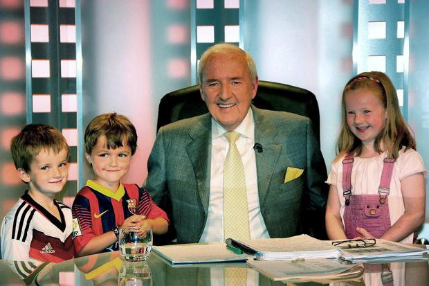 Below: Bill on set with his grandchildren during RTE's World Cup coverage last year