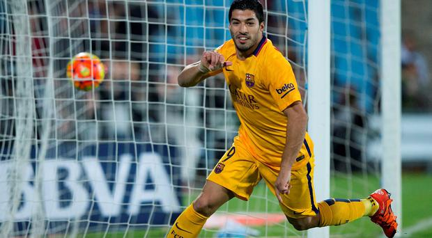 Luis Suarez of FC Barcelona celebrates scoring their opening goal during the La Liga match between Getafe CF and FC Barcelona at Coliseum Alfonso Perez