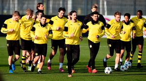 Dortmund's players warm up during a training session