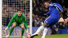 Watford's goalkeeper Jonathan Bond (L) watches Chelsea's Didier Drogba shoot during their FA Cup third round match at Stamford Bridge in London