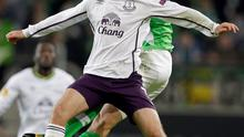 Everton's Aidan McGeady, front, and Wolfsburg's Marcel Schaefer challenge for the ball during the Europa League Group H soccer match between VfL Wolfsburg and Everton FC