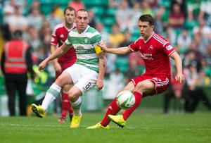Celtic's Scott Brown (left) and Aberdeen's Andrew Considine battle for the ball during the Scottish Premiership match at Celtic Park, Glasgow