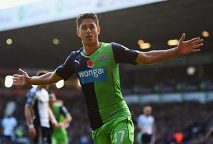 Ayoze Perez of Newcastle United celebrates as he scores their first goal during the Barclays Premier League match between West Bromwich Albion and Newcastle United