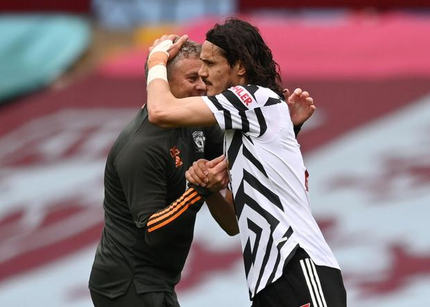 Manchester United's Edinson Cavani with manager Ole Gunnar Solskjaer after the win against Aston Villa. Photo: Reuters