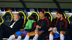 Manchester United's Cristiano Ronaldo watches from the bench after being substituted during his team's Champions League defeat to Young Boys in Bern, Switzerland. Photo: Arnd Wiegmann/Reuters