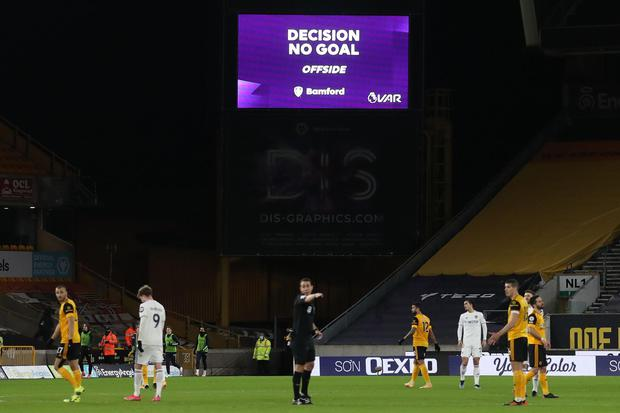 """A screen displays the """"No Goal"""" VAR decision following a review of Leeds United's Patrick Bamford's (left) disallowed goal against Wolves at Molineux last February."""