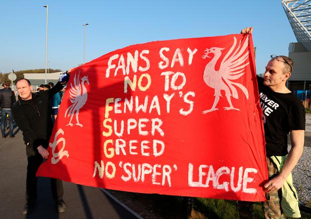 Fans hold up a protest banner against Liverpool and the European Super League outside Elland Road prior to the Premier League match between Leeds United and Liverpool. Photo: Clive Brunskill/Getty Images