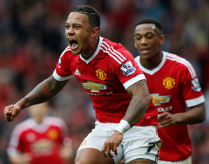 Manchester United's Memphis Depay celebrates after scoring their first goal in the 3-0 win over Sunderland Photo: Andrew Yates