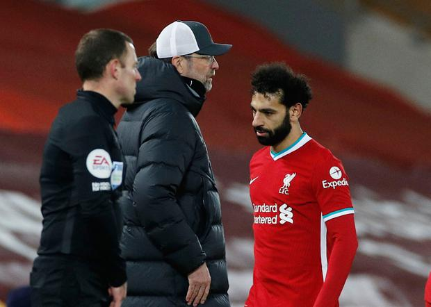 Liverpool's Mohamed Salah walks past manager Jurgen Klopp after being substituted against Chelsea during the week. Photo: Phil Noble/Reuters