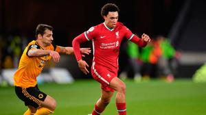 Liverpool's Trent Alexander-Arnold battles for the ball with Wolverhampton Wanderers' Jonny Castro Otto. Photo: PA Wire