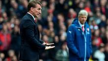 Liverpool's Northern Irish manager  Brendan Rodgers (L) gestures as Arsenal's French manager Arsene Wenger looks on