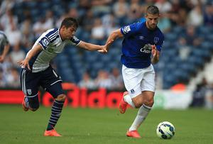 West Brom's Cristian Gamboa battles for the ball with Everton's Kevin Mirallas