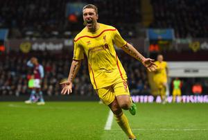 Rickie Lambert of Liverpool celebrates scoring their second goal during the Barclays Premier League match between Aston Villa and Liverpool