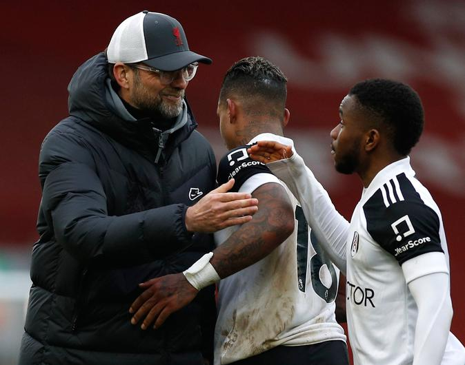 Jurgen Klopp with Fulham players Mario Lemina and Ademola Lookman. Photo: Phil Noble/PA