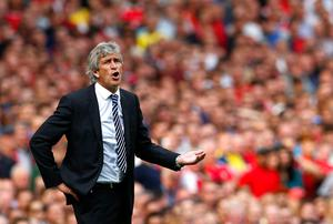 Manchester City's manager Manuel Pellegrini reacts during their Premier League match against Arsenal at the Emirates stadium
