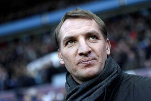 Liverpool's Northern Irish manager Brendan Rodgers arrives ahead of the English Premier League football match between Aston Villa and Liverpool