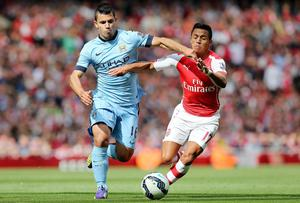 Manchester City's Sergio Aguero (left) is challenged by Arsenal's Alexis Sanchez