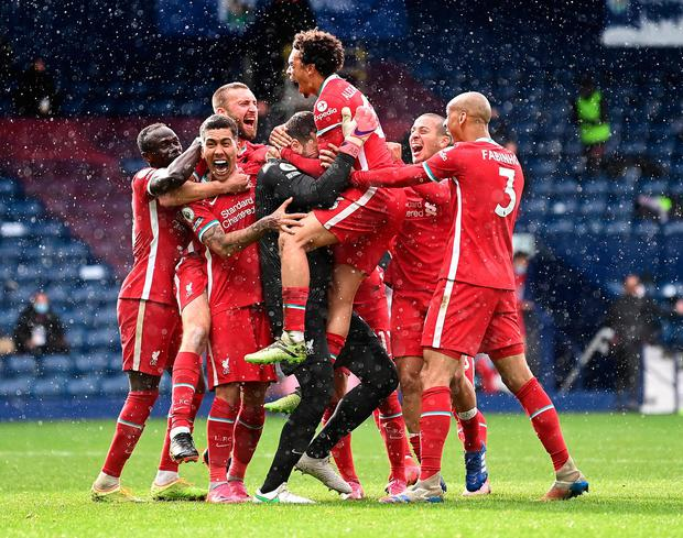 Alisson Becker of Liverpool is congratulated by Sadio Mane, Roberto Firmino, Thiago Alcantara, Trent Alexander-Arnold and Fabinho after scoring the winning goal against West Bromwich Albion Liverpool at The Hawthorns. (Image: Getty Images)