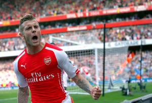 Arsenal's Jack Wilshere celebrates after scoring a goal against Manchester City