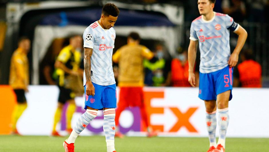 Manchester United's Jesse Lingard, left, and Harry Maguire look dejected after their side's defeat to Young Boys on Tuesday. Photo: Arnd Wiegmann/Reuters