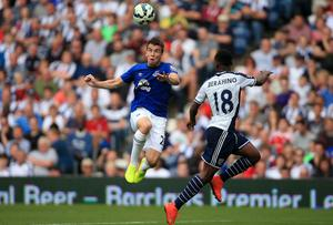 Everton's Seamus Coleman battles for the ball with West Brom's Saido Berahino