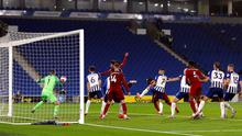 Mo Salah scores a near-post header to seal victory for Liverpool against Brighton last night
