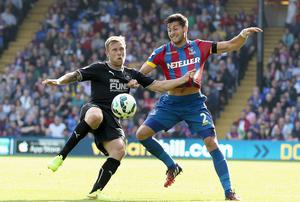 Crystal Palace's Joal Ward and Burnley's Scott Arfield battle for the ball