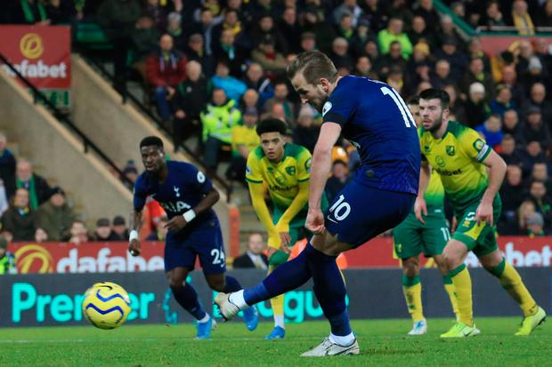 Tottenham Hotspur's Harry Kane scores from the penalty spot to earn his side a draw at Carrow Road. Photo: Getty