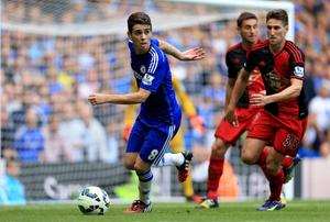 Chelsea's Oscar and Swansea City's Federico Fernandez compete for the ball during the Barclays Premier League match at Stamford Bridge