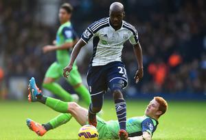 Youssuf Mulumbu of West Bromwich Albion evades Jack Colback of Newcastle United during the Barclays Premier League match between West Bromwich Albion and Newcastle United