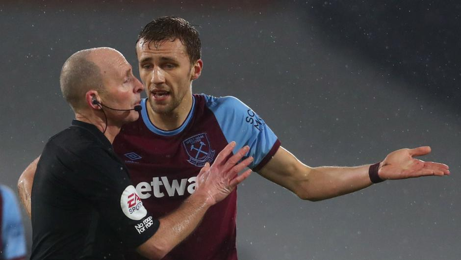 Tomas Soucek remonstrates with referee Mike Dean after receiving a red card against Fulham. Image credit: PA.