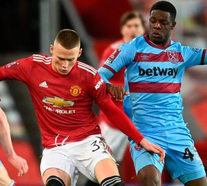 West Ham's Ademipo Odubeko (right) battles for possession with Manchester United's Scott McTominay. Photo: Michael Regan/Getty Images