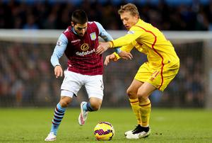 Carles Gil de Pareja Vicent of Aston Villa looks to go past Lucas Leiva of Liverpool  during the Barclays Premier League match between Aston Villa and Liverpool