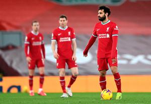 A dejected Mohamed Salah looks on after Raheem Sterling scored Manchester City's third goal at Anfield on Sunday. Photo: PA