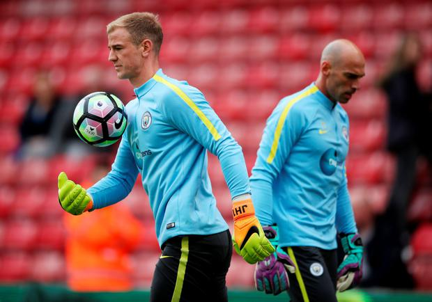 Manchester City's Joe Hart and Willy Caballero (right) warm up before the Premier League match at The Bet365 Stadium, Stoke-on-Trent Photo: PA