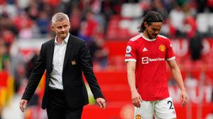Manchester United manager Ole Gunnar Solskjaer (left) and Edinson Cavani on the pitch after the Premier League defeat to Aston Villa match at Old Trafford, Manchester