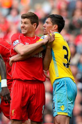 Steven Gerrard tussles with Martin Kelly during his final game at Anfield