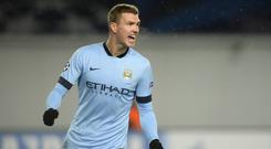 Manchester City striker Edin Dzeko could be out for several weeks with a calf injury
