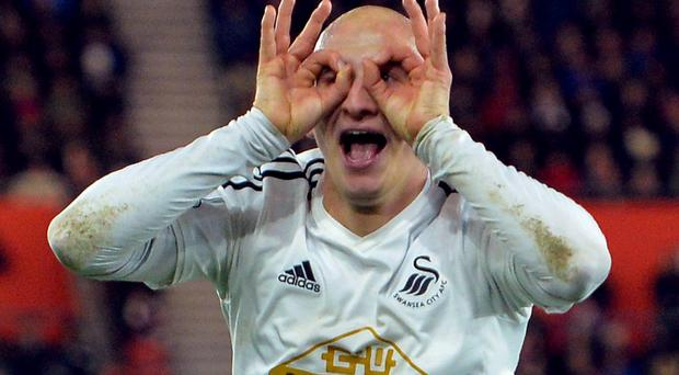 Swansea City's English midfielder Jonjo Shelvey celebrates scoring the opening goal during the English Premier League football match between Southampton and Swansea at St Mary's Stadium