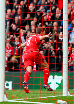 Liverpool's Steven Gerrard celebrates scoring his side's second goal during the Barclays Premier League match at Anfield,