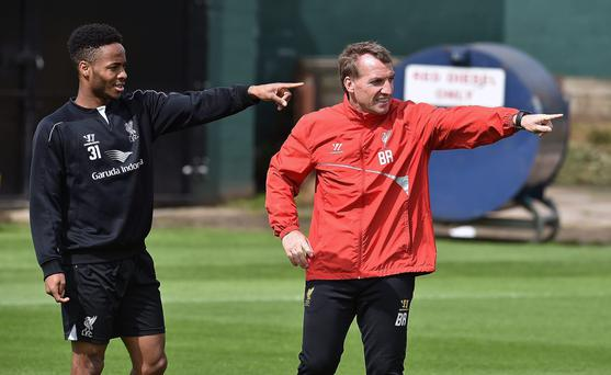 Raheem Sterling and Brendan Rodgers during Liverpool training