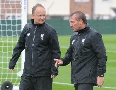 Sean O'Driscoll and Brendan Rodgers in conversation at Liverpool's Melwood training centre yesterday