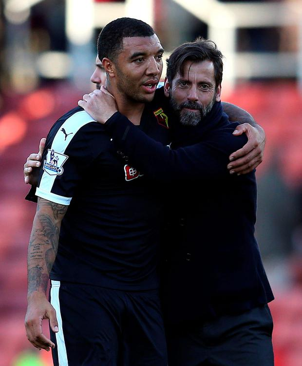 Watford manager Quique Sanchez Flores embraces Troy Deeney after the final whistle yesterday