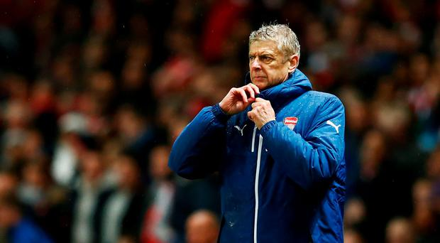 Arsene Wenger's struggles with his coat can be symbolic