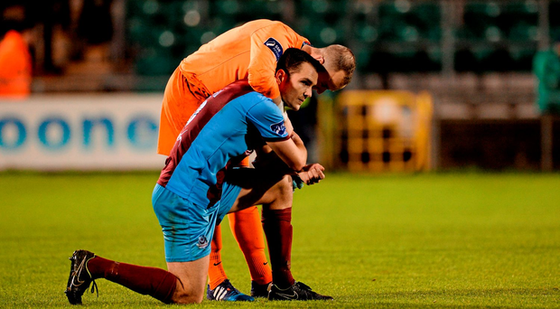 Michael Daly and goalkeeper Micheál Schlingermann show their pain after Drogheda United's relegation