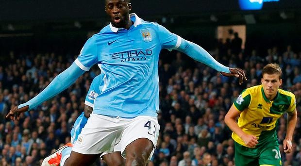 Manchester City's Ivorian midfielder Yaya Toure (L) scores their second goal from the penalty spot during the English Premier League football match between Manchester City and Norwich City at The Etihad Stadium